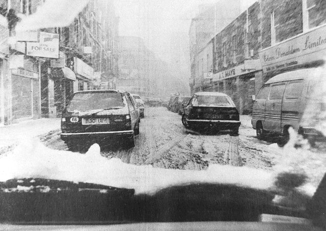 A driver's view of the snow on the High Street in 1993.