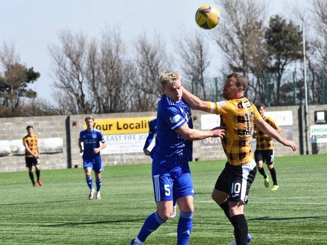 Kevin Smith battles it out with Peterhead's Jason Brown. Pic by Kenny Mackay.