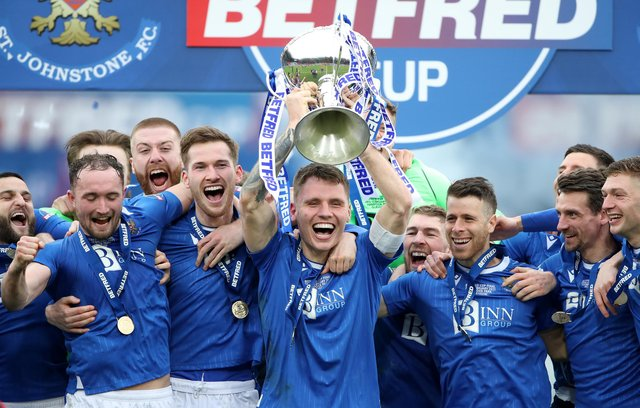 Jason Kerr of St Johnstone lifts the Betfred Cup after his side beat Livingston in the final at Hampden Park on Sunday (Photo by Ian MacNicol/Getty Images)