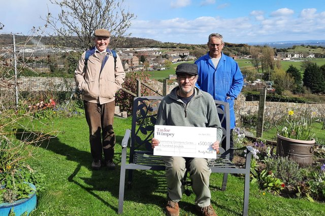 Inverkeithing Community Garden volunteers - Ian Shepherd, Ian Walker, Paul Francis with their donation from Taylor Wimpey East Scotland.