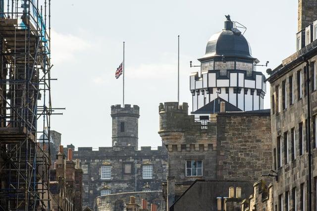 PIC LISA FERGUSON: Flags fly at half mast on Edinburgh Castle, and City Chambers