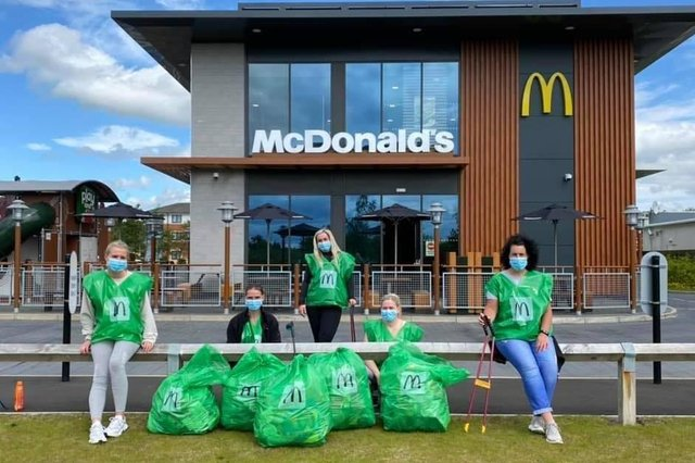 Staff from Glenrothes McDonald's with some of the rubbish that they collected.