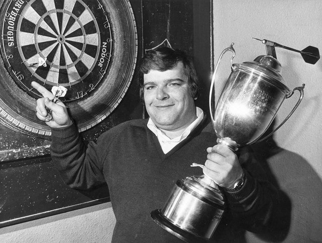 Jocky Wilson in Kirkcaldy with the Embassy Darts World Championship trophy after beating John Lowe in 1982