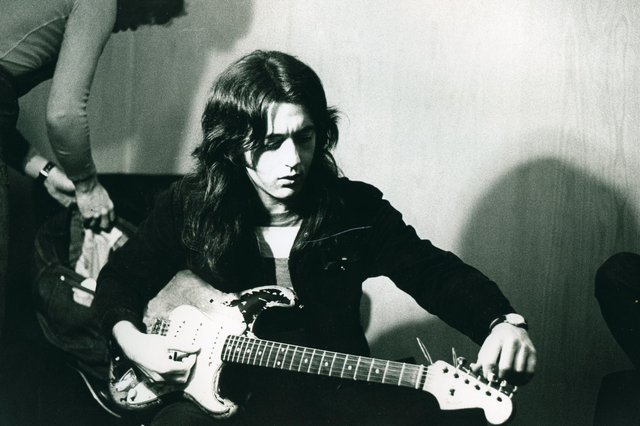 Rory Gallagher tuning up in the studo (Pic: Mick Rock/Strange Music)
