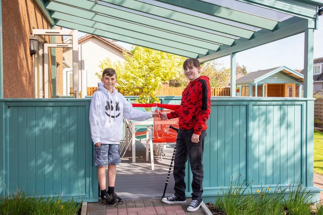 Cupar brothers Elliot and Aaron Berghuis mark the re-opening of TCCL Lodge and its new gazebo funded by the Meikle Trust.  Pic: Caroline Trotter Photography.