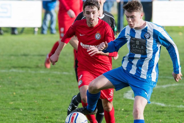 Reece Ritchie, seen here in red playing for Lochee, is one of Chris Macpherson's summer signings. Pic by Ian Georgeson