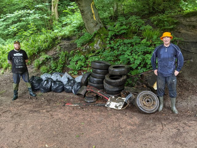 Andrew Dunlop is pictured in the left with Keith Wotherspoon on the right with the bags of rubbish and tyres collected from the Den.
