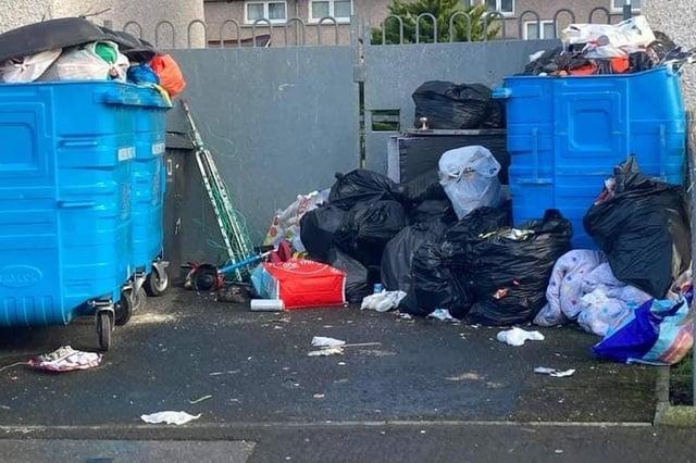 Illegal dumping in a bin store.