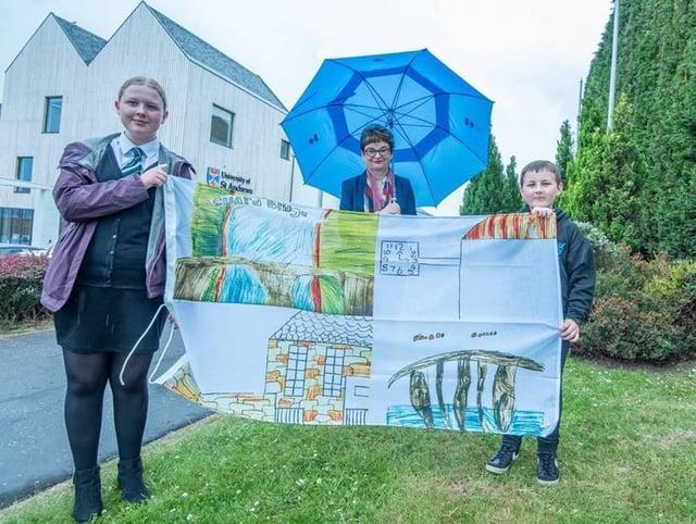 From left: senior pupil Zoe Stephenson, principal Sally Mapstone and junior pupil Adrian Frankowski-Smith.