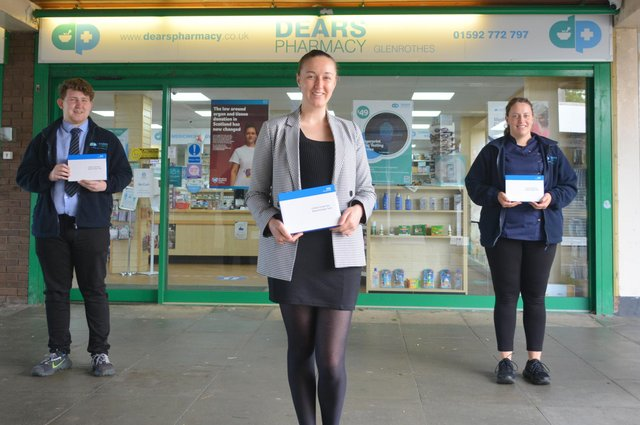 Staff at Dears Pharmacy, Glenrothes, with the home testing kits.