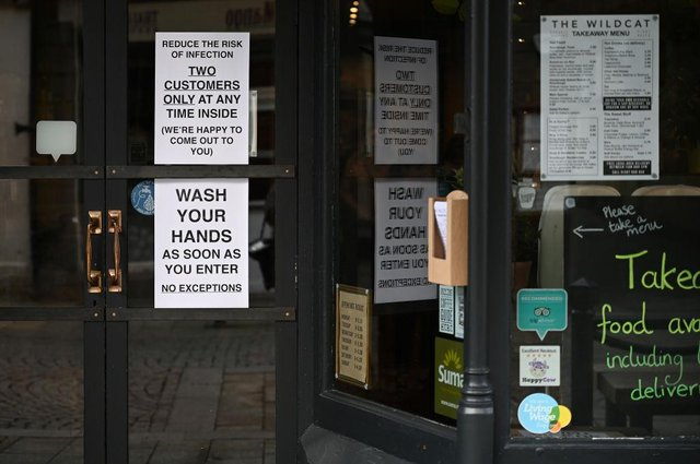 Signs in a coffee shop in Main Street Fort William as people are asked to stop travelling to the Scottish Highlands in a bid to avoid spreading the coronavirus (Photo: Jeff J Mitchell/Getty Images)