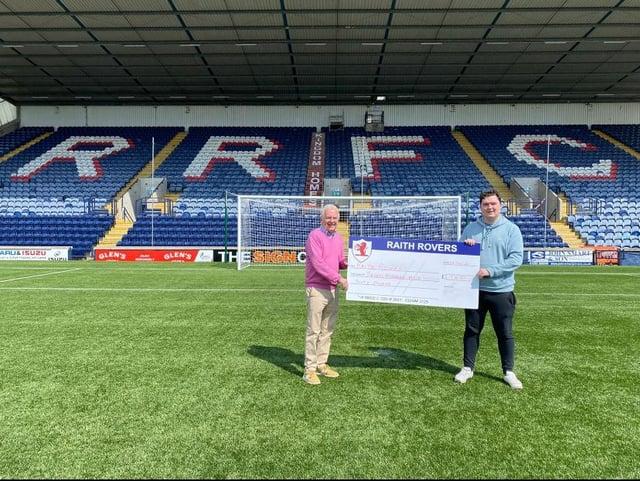 Martin Glass presents a cheque to Raith Rovers director Tom Morgan