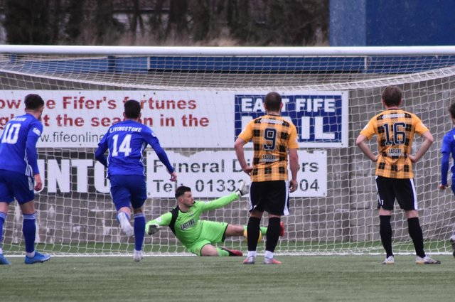 Brett Long gets a crucial block on Mitch Megginson's penalty. The goalie was then up quickly to beat away the rebound. Pic by Kenny Mackay.
