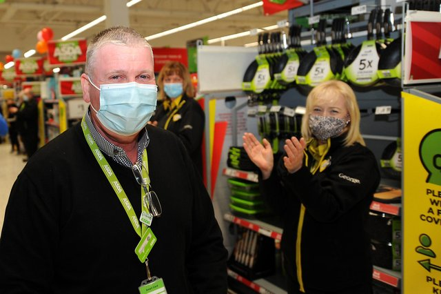 Stephen Gallagher being applauded by an Asda colleague. Pic: Fife Photo Agency.