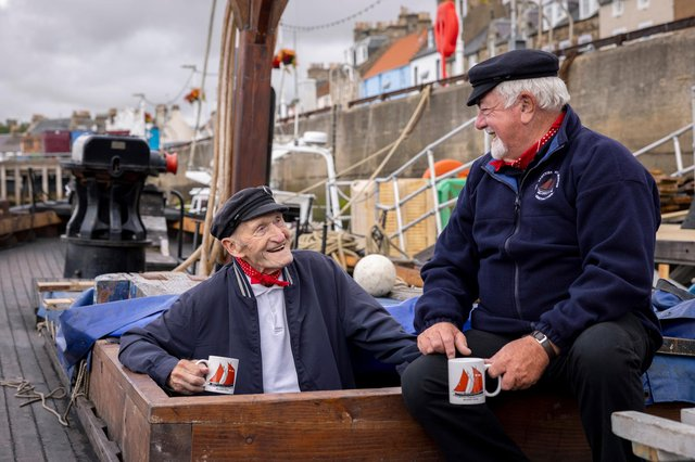 Scottish Fisheries Museum's iconic 'Fifie' the Reaper 95 year old Coull Deas MBE, former long-time skipper, and Boat Club volunteer Jim Wilson, take a break after working on the £1million conservation of the Scottish Fisheries Museum's iconic 'Fifie' Reaper, © Martin Shields