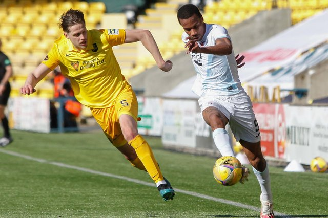 Raith sub Manny Duku aims to get beyond Jack Fitzwater, one of Livingston's goalscorers.