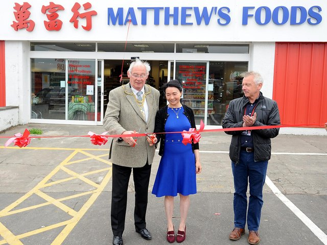 Fife Provost Jim Leishman cuts the ribbon with owner Amy Ng to officially open Matthew's Foods Oriental Supermarket. Pic: Fife Photo Agency