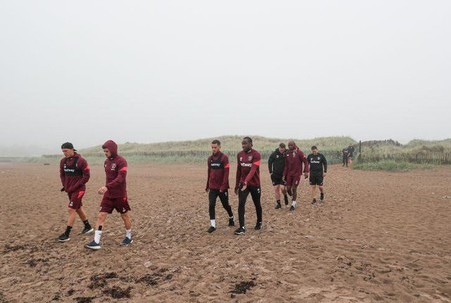 The players arriving on West Sands.