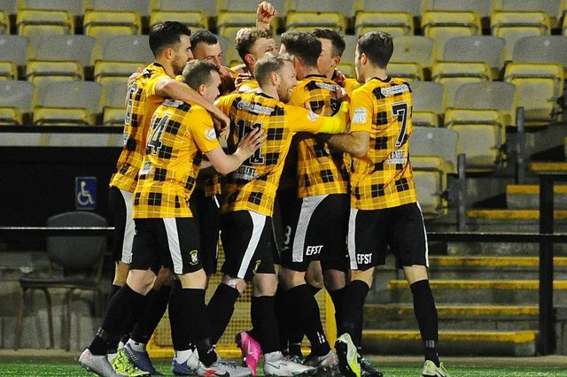East Fife's players celebrate in front of an empty stand last season....but that will change soon. Pic by Michael Gillen