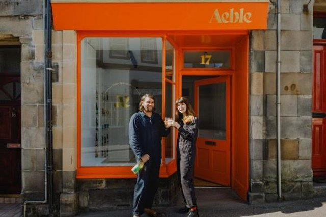 Grant and Jaye outside their new shop.