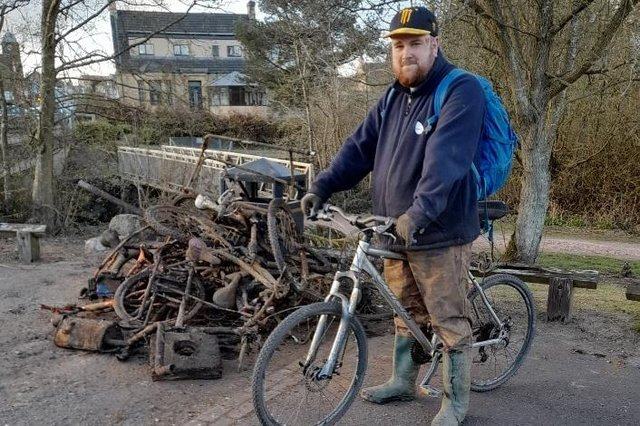 Andrew Dunlop with some of the rubbish that he has pulled from the River Ore.