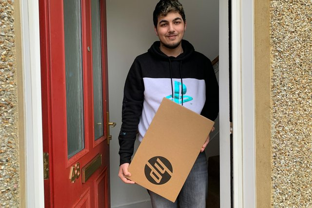 Rahaeem Akhtar, HNC Electrical Engineering student from Cowdenbeath with one of the laptops