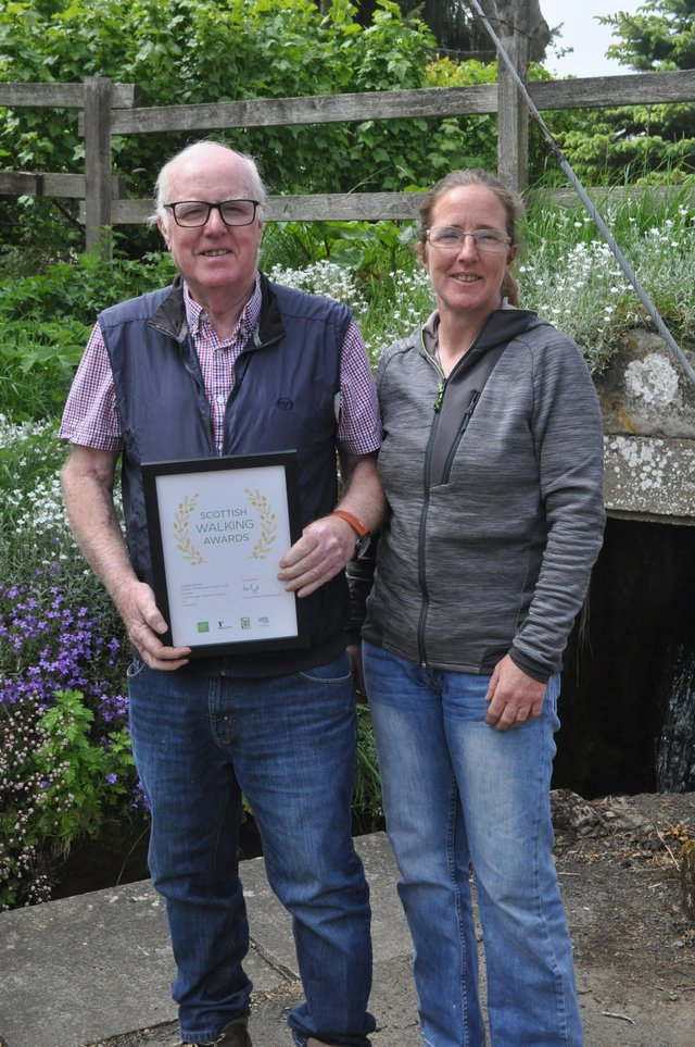 From left: Bob Cooper, operations manager at Alcan and Hayley MacDonald, health and safety officer at Alcan with the walking award.