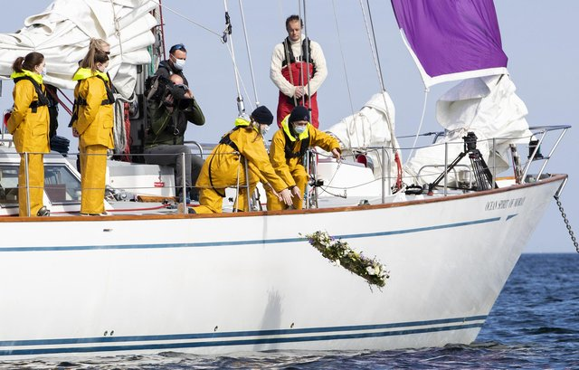 Young sailors at Gordonstoun lay a wreath off the coast of Hopeman Harbour, where Prince Philip first learned to sail.