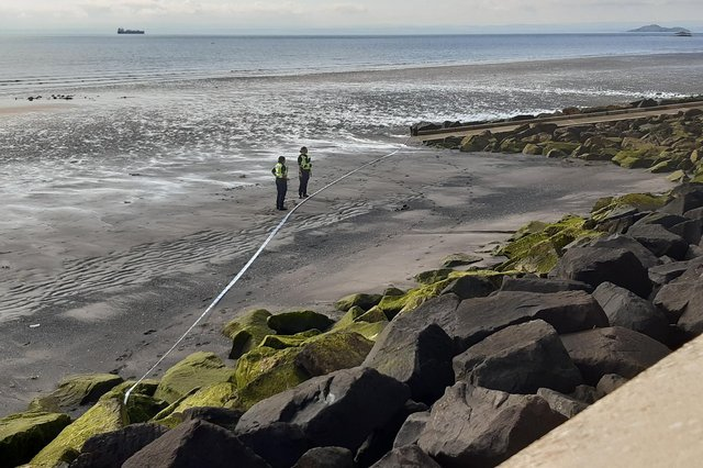 Police officers cordoned off part of the beach below the seawall at Kirkcaldy