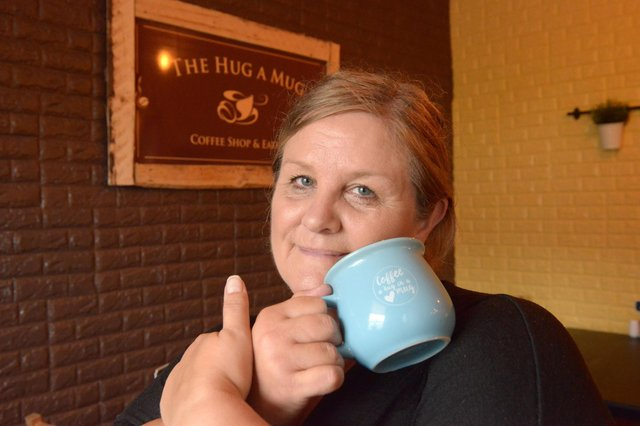 Owner Laura Davidson at The Hug A Mug Coffee Shop and Eatery (Pic: George McLuskie)