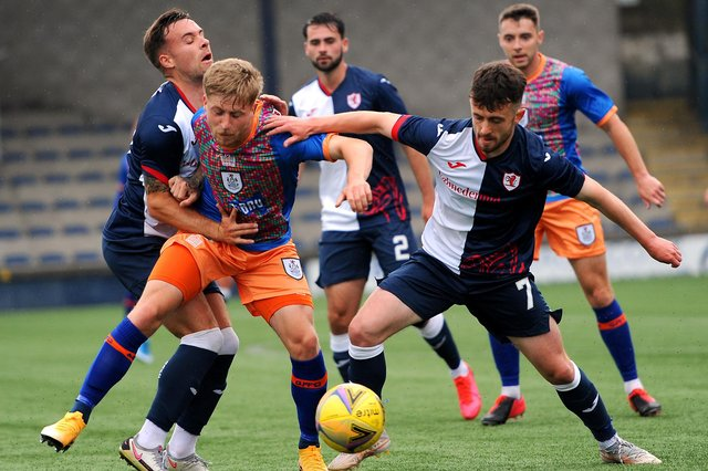 Lewis Vaughan , left, and Aidan Connolly close in on Queen's PArk's Thomas Robson, as Reghan Tumilty looks on (picture by Fife Photo Agency)