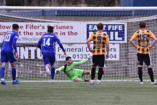 Brett Long stops Mitch Megginson's penalty. Pic by Kenny Mackay