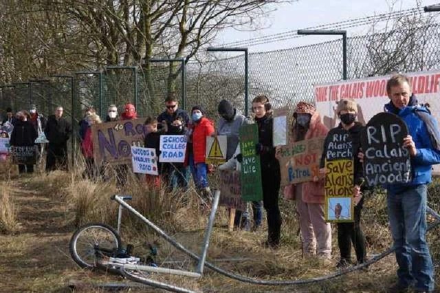 Campaigners protesting to save the woods at the site of the proposed new learning campus