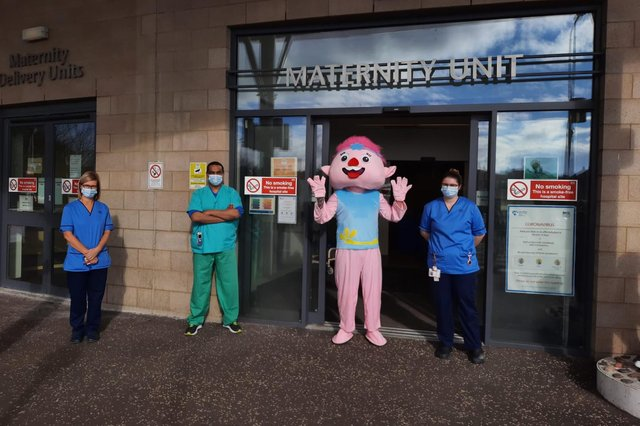 Brian Allan with staff from the maternity ward.