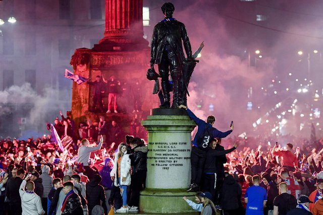 Rangers fans gather in George Square to celebrate the club winning the Scottish Premiership for the first time in 10 years, (Photo by Jeff J Mitchell/Getty Images)