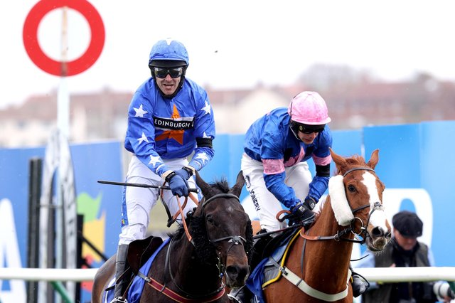 Mighty Thunder ridden by Tom Scudamore (left) wins the Coral Scottish Grand National Handicap Chase at Ayr Racecourse. (Photo by Jeff Holmes-Pool/Getty Images)