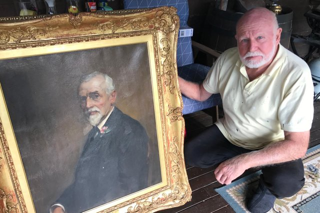David Boyd Young with the portrait of his great-grandfather John Boyd.