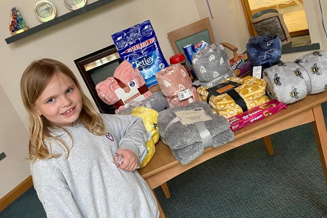 Kaidence with her donation for Victoria Hospice.