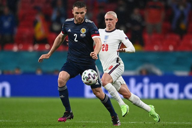 Scotland ace Stephen O'Donnell is pictured with England star Phil Foden during Friday's clash (Pic by Getty Images)
