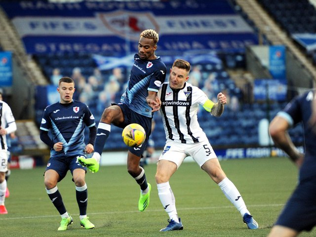 Raith's Manny Duku flicks the ball past Dunfermline's Euan Murray as the two sides met earlier this season (Pic: Fife Photo Agency)