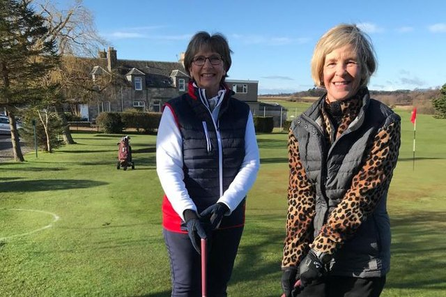 Captain Jan Stuart (left) and vice-captain Heather Fleming on their way to the first tee.
