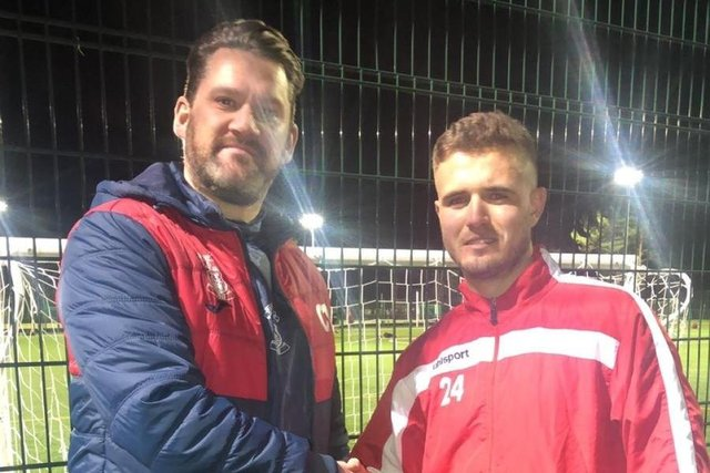 Brad Ness, pictured here with manager Chris Macpherson, has again committed his future to the Canniepairt club