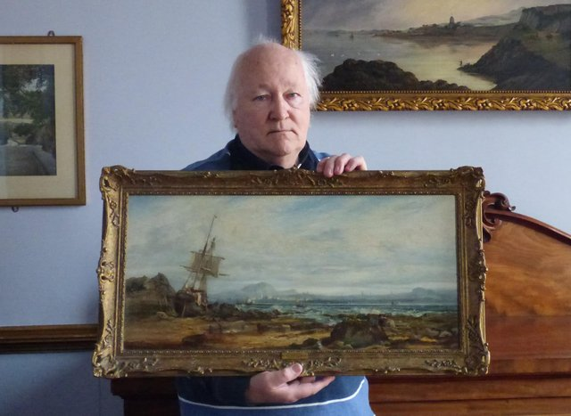 George McLauchlan with the oil painting which shows a sailing ship, aground on the foreshore adjacent to the Black Rock with the Edinburgh skyline in the background.