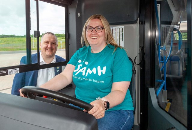 Douglas Robertson Stagecoach East Scotland managing director, and Chelsea Graham - SAMH Peer Practitioner, launch the mobile support  bus