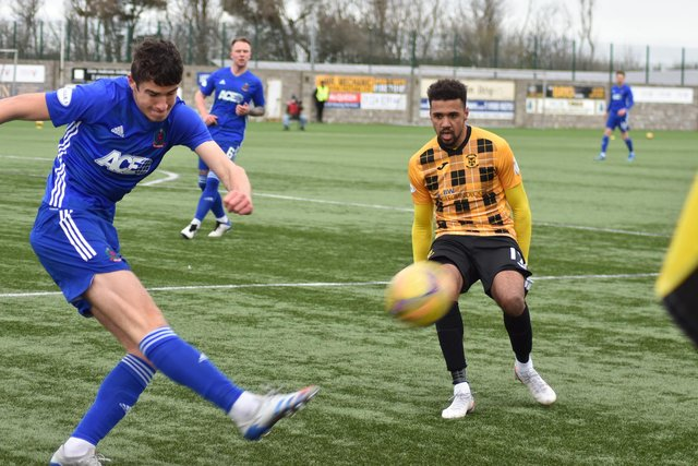 Cove clear their lines under pressure from Fife forward Nathan Austin. Pic by Kenny Mackay