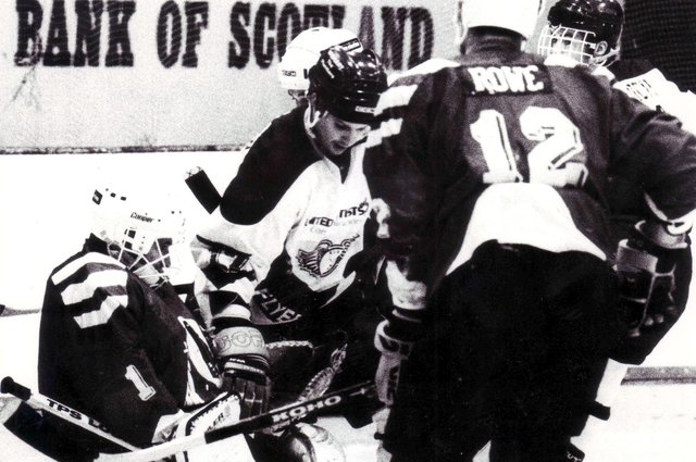 Fife Flyers v Whitley Warriors - pictured are Mark Morrison, and Warriors' defenceman Mike Rowe (Pic: Bill Dickman/Fife Free Press)