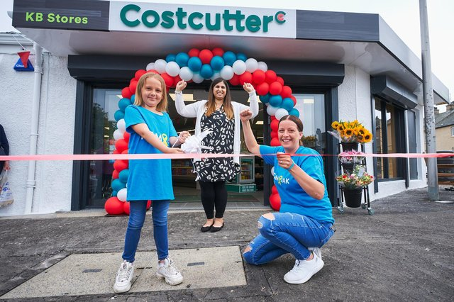Madison Martin cuts the ribbon with her mum Samantha Kirk and store owner, Anila Anwar. Pic: Fraser Band.