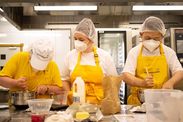Team members of The Sunshine Kitchen at work in the kitchens at Rothes Halls.