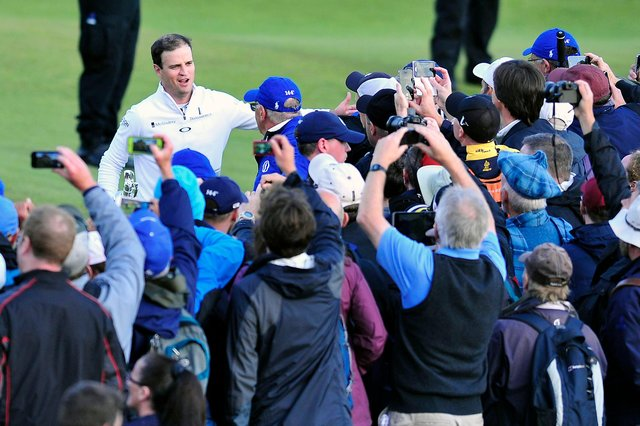 Open winner Zach Johnson takes the acclaim of the St Andrews crowd in 2015. Pic by Michael Gillen