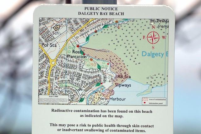 A SEPA sign warns of radiation of Dalgety Bay Beach.